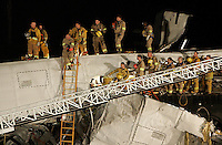 LOS ANGELES,CA - SEPTEMBER 12,2008: Firefighter rescue teams watch as the body of a LAPD officer is removed from the metrolink train disaster scene in Chatsworth, September 12, 2008.