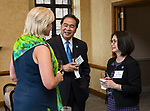 Marty Wilke, left, president and general manager of CBS-owned WBBM-Channel 2, chats with DePaul President A. Gabriel Esteban, Ph.D., and his wife Josephine during a gathering of women leaders Thursday, July 20, 2017, at The Chicago Club. The event was organized to welcome the Estebans to Chicago and introduce them to some of Chicago&rsquo;s most influential women.  <br />