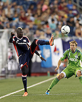 New England Revolution midfielder Saer Sene (39) redirects a pass. In a Major League Soccer (MLS) match, the New England Revolution tied the Seattle Sounders FC, 2-2, at Gillette Stadium on June 30, 2012.