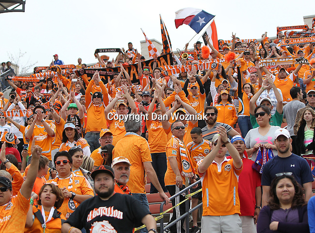 Houston Dynamo fans in action during the game between the FC Dallas and the Houston Dynamo at the FC Dallas Stadium in Frisco,Texas.