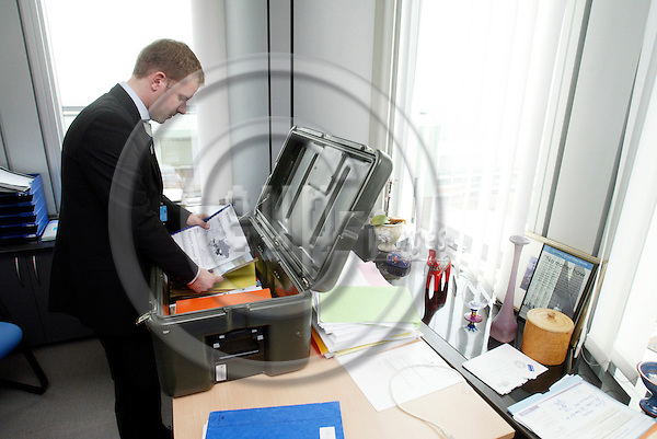 BRUSSELS - BELGIUM - 10 MAY 2006 -- Anders EKBERG assistant to MEP Cecilia MALMSTRÖM packing the moving box before it's transportation to Strasbourg for the nest parliament session. PHOTO: ERIK LUNTANG / EUP-IMAGES