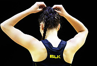Karin Burger adjusts her hair during the ANZ Premiership netball match between the Central Pulse and Northern Stars at TSB Bank Arena in Wellington, New Zealand on Monday, 8 May 2017. Photo: Dave Lintott / lintottphoto.co.nz