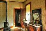 Billings Farmhouse. Bedroom windows with houseplants.