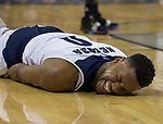 Nevada forward  Tre'Shawn Thurman (0) reacts after hitting the floor against San Diego State in the second half of an NCAA college basketball game in Reno, Nev., Saturday, March 9, 2019. (AP Photo/Tom R. Smedes)