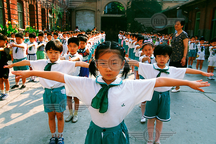 Mark Henley/Panos Pictures...China, Shanghai..Morning exercises at primary school, during assembly in courtyard.