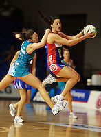 20.03.2010 Mystics Larrissa Willcox and Thunderbirds Kate Beveridge in action during the ANZ Champs Netball match between the Mystics and Thunderbirds at Trusts Stadium in Auckland. Mandatory Photo Credit ©Michael Bradley.