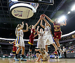 SIOUX FALLS, SD - FEBRUARY 10:  Peyton Stolle #25 and Tagyn Larson #31 from Roosevelt battle for the rebound with Jessica Mieras #43 and Katie Messler #40 from O'Gorman in the second half of their game at the Denny Sanford Premier Center. (Photo by Dave Eggen/Inertia)