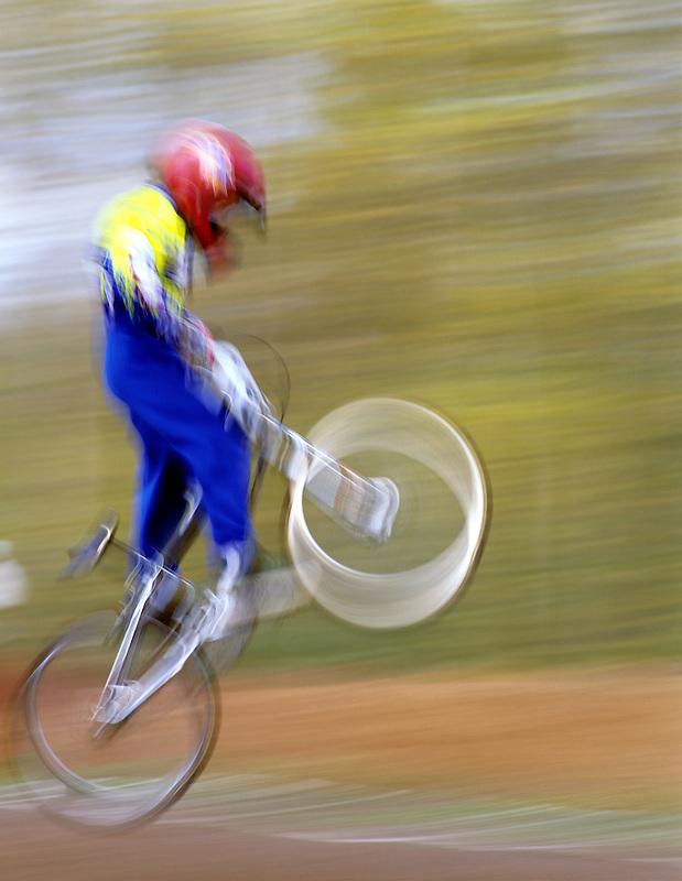 BMX bike rider in air off jump. Cottage Grove, Oregon.