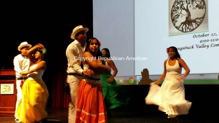 WATERBURY - Wilby High School students (left to right) Marbinson Ottewarde, Roxanna Pindo, Marco Lopez, Arianny Ottewarde, Darina Sosa and Leezaury Guzman perform a traditional Dominican dance.