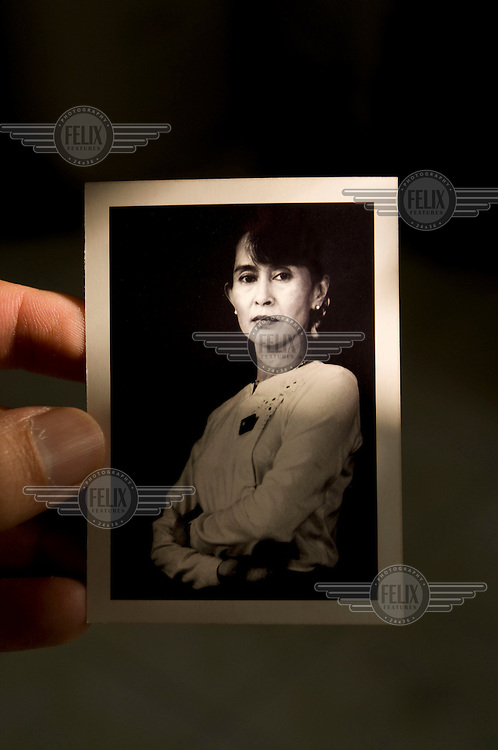 A photograph of Aung San Suu Kyi chairperson of the National League for Democracy (NLD). The photograph was taken by Nic Dunlop in Rangoon in 1996 just after her release from her first term under house arrest.