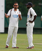 Paul Weekes (L) in discussion with Hornsey captain Garfield Struthers during the Middlesex Cricket League Division Two game between Shepherds Bush and Hornsey at Bromyard Ave, London on Sat Aug 1, 2015