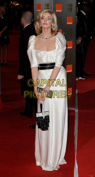 TAMSIN EGERTON.Arrivals at the Orange British Academy Film Awards 2010 at the Royal Opera House, Covent Garden, London, England..February 21st, 2010.BAFTA BAFTAs full length maxi white dress black waistband silk satin belt bag shoulder pads sleeves .CAP/CAN.©Can Nguyen/Capital Pictures.