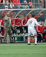 16 May 09: Chicago Fire head coach Denis Hamlett shouts out instructions to Chicago Fire midfielder Mike Banner #18 during action at BMO Field in a game between the Chicago Fire and Toronto FC..Chicago Fire won 2-0..