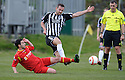 Rovers' Chris Boyle challenges Elgin's Jamie Duff.....