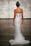 Model walks runway in a VIP element strapless lace mermaid with lace & tulle train, from Inbal Dror Fall 2018 bridal collection on October 5, 2017; during New York Bridal Fashion Week.