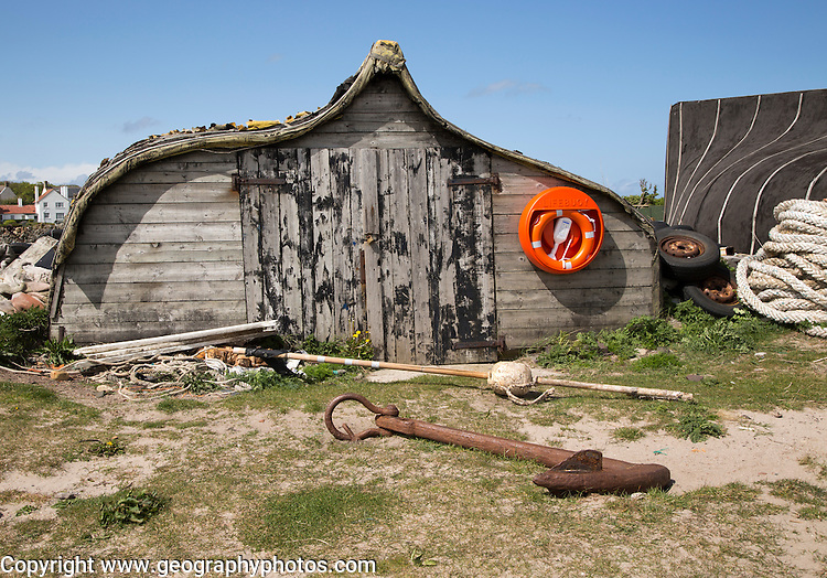 Upturned boat used as storage shed, Holy Island, Lindisfarne, Northumberland, England, UK
