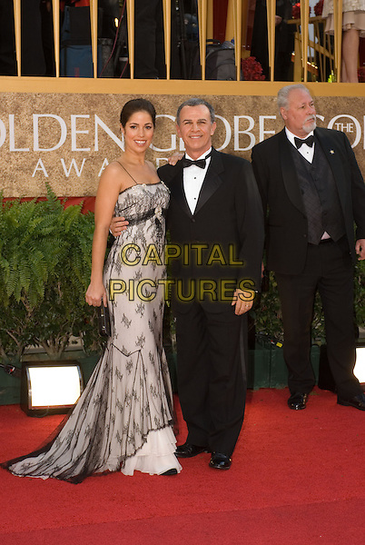"ANA ORTIZ & TONY PLANA.Red Carpet Arrivals - 64th Annual Golden Globe Awards, Beverly Hills HIlton, Beverly Hills, California, USA..January 15th 2007.globes full length black suit tuxedo dress white lace sheer.CAP/AW.Please use accompanying story.Supplied by Capital Pictures.© HFPA"" and ""64th Golden Globe Awards"""