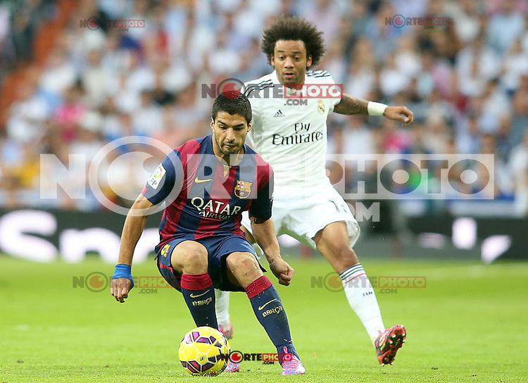 Real Madrid's Marcelo Vieira (r) and FC Barcelona's Luis Suarez during La Liga match.October 25,2014. (ALTERPHOTOS/Acero) /nortephoto.com