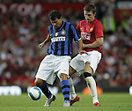 Manchester United's Michael Carrick tackles Dejan Stankovic of Inter Milan. Pic SPORTIMAGE/Dave Thompson..Pre-Season Friendly..Manchester United v Internazionale..1st August, 2007..--------------------..Sportimage +44 7980659747..admin@sportimage.co.uk..http://www.sportimage.co.uk/