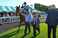 Winner of The Sharp's Doom Bar Handicap Raincall ridden by Harry Bentley and trained by Henry Candy is led into the Winners enclosure  during Evening Racing at Salisbury Racecourse on 25th May 2019