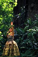 Woman dancing hula for the prince lot hula festival at moana lua gardens, Oahu