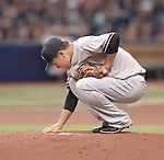 Masahiro Tanaka (Yankees),<br /> APRIL 18, 2015 - MLB :<br /> Masahiro Tanaka of the New York Yankees touches the pitcher's plate before delivering the first pitch in the first inning during the Major League Baseball game against the Tampa Bay Rays at Tropicana Field in St. Petersburg, Florida, United States. (Photo by AFLO)