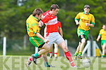 Gneeveguilla's Danny O'Connor and Paidi O'Murchy of Dingle chase the loose ball last Sunday afternoon in Gneeveguilla for round 2 of the Garvey's Supervalue County Senior Championship.