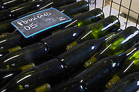 bottles stored in wire cages chalk board dom h & g buisson st romain cote de beaune burgundy france
