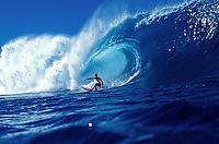 "A surfer masterfully rides the """"tube""""  at world famous Pipeline beach at the North Shore, Oahu"
