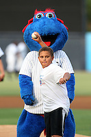 Tampa Yankees mascot blue helps out during the ceremonial first pitch before a game against the Clearwater Threshers at Steinbrenner Field on June 22, 2011 in Tampa, Florida.  The game was suspended due to rain in the 10th inning with a score of 2-2.  (Mike Janes/Four Seam Images)