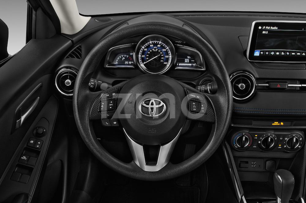 Car pictures of steering wheel view of a 2017 Toyota Yaris-iA AT 4 Door Sedan Steering Wheel