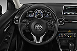 Car pictures of steering wheel view of a 2017 Toyota Yaris-iA AT 4 Door Sedan Steering Wheel