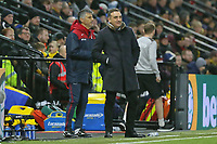 (L-R) Swansea assistant coach Joao Mario Ferreira Oliveira and Swansea manager Carlos Carvalhal stand on the touch line to the Premier League match between Watford and Swansea City at the Vicarage Road, Watford, England, UK. Saturday 30 December 2017