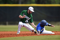 Farmingdale State Rams Tom Rydzewski (24) attempts to tag Delvis Baez (15) sliding back to second during a game against the U-Mass Boston Beacons at North Charlotte Regional Park on March 19, 2015 in Port Charlotte, Florida.  U-Mass Boston defeated Farmingdale 9-5.  (Mike Janes/Four Seam Images)