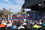 Nevada's Garrett Felling and Air Force's Laurynas Galdikas compete in an intercollegiate boxing match at TJ's Corral at Carson Valley Inn, in Minden, Nev., on Saturday, Sept. 13, 2014. Felling won on a TKO.<br /> Photo by Cathleen Allison