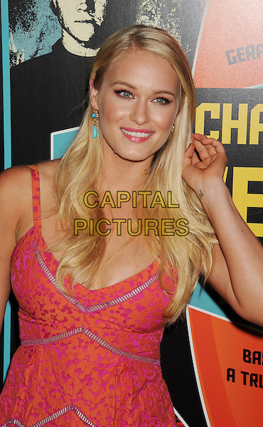 Leven Rambin.Special Screening of 'Chasing Mavericks' held at The Pacific Grove Stadium 14 in Los Angeles, California, USA..October 18th, 2012.half length pink turquoise earrings orange print  dress hand arm.CAP/ROT/TM.©Tony Michaels/Roth Stock/Capital Pictures