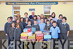 Pupils from 3rd, 5th and 6th class of Cullina National School, Beaufort, pictured with Moira Cronin, Bertie O'Connor and Lisa Fogarty as they presented their shoebox's of toys to Margaret Scully, Team Hope, at the school on Thursday afternoon.....