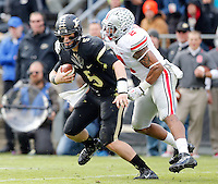 Ohio State Buckeyes linebacker Ryan Shazier (2) sacks Purdue Boilermakers quarterback Danny Etling (5) during the third quarter of the NCAA football game at Ross-Ade Stadium in West Lafayette, Ind. on Nov. 2, 2013. (Adam Cairns / The Columbus Dispatch)
