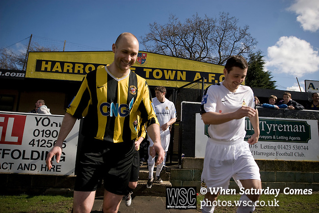 Southport players dressed in their change colours of all white taking to the pitch before their team's match against Harrogate Town at Wetherby Road, Harrogate. The Conference North match was won 3-2 by Southport, a result which kept the Sandgrounders on course for top spot in the division while Harrogate Town remained bottom.