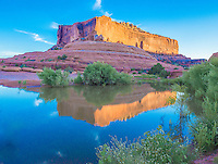The Merrimack Butte reflected in a summer monsoon pool. BLM lands near Moab, Utah