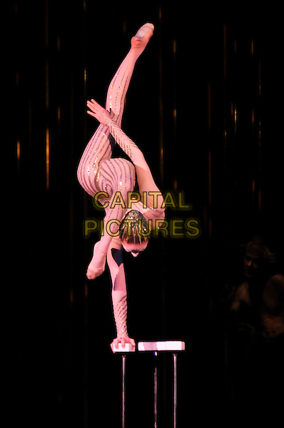 "HANDBALANCING ON CANES - Irina Naumenko.""Varekai"" Cirque Du Soleil Performance,.Royal Albert Hall, London, England,.January 5th 2007..full length circus acrobat costume make-up face painted performer contortionist gold sequined striped body suit flesh coloured leotard all-in-one beaded head piece hat.CAP/PL.©Phil Loftus/Capital Pictures"