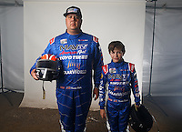 Mar. 21, 2014; Chandler, AZ, USA; LOORRS pro 4 driver Brandon Bailey (left) and son, junior 1 driver Madix Bailey pose for a portrait prior to round one at Wild Horse Motorsports Park. Mandatory Credit: Mark J. Rebilas-USA TODAY Sports