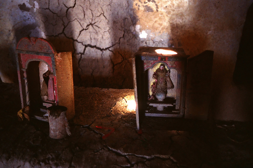 Aging oratorios, or prayer boxes, decay in a crumbling adobe country church near Inquisivi, Bolivia.