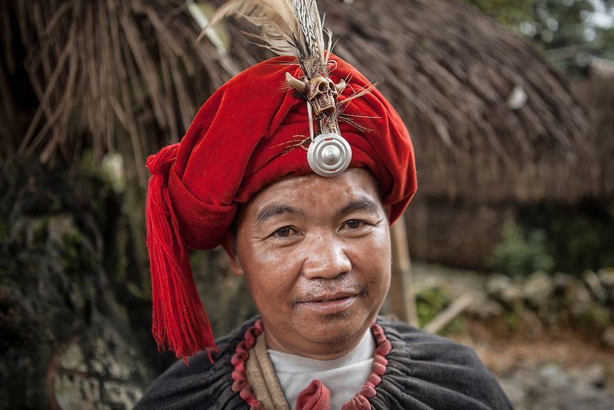 "A Wa village elder in the village of Wengding. The Wa, which literally means ""mountain dwellers"", is the hilltribe that inhabit the Sino-Burmese. Known as one of the last headhunting tribe until mid-twentieth century, their population in both countries now approximately no more than one million. In the homogenous society of modern China, Wa is one of more than 50 officially state-recognized ethnic minorities. They can be found around the southwestern corners of Yunnan province."