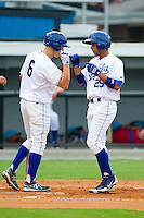Ramon Torres (25) of the Burlington Royals is congratulated at home plate by teammate Tyler Chism (6) after hitting a home run against the Pulaski Mariners at Burlington Athletic Park on July 20, 2013 in Burlington, North Carolina.  The Royals defeated the Mariners 6-5.  (Brian Westerholt/Four Seam Images)