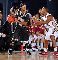 18 November 2010:  FIU's Phil Gary (4) handles the ball while being defended by FSU's Ian Miller (30) in the first half as the Florida State University Seminoles defeated the FIU Golden Panthers, 89-66, at the U.S. Century Bank Arena in Miami, Florida.