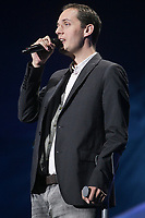 """Grand Corps Malade performs at the """"Paris-Quebec"""" show of the 44th Festival d'ete de Quebec on the Plains of Abraham in Quebec city Thursday July 7, 2011."""