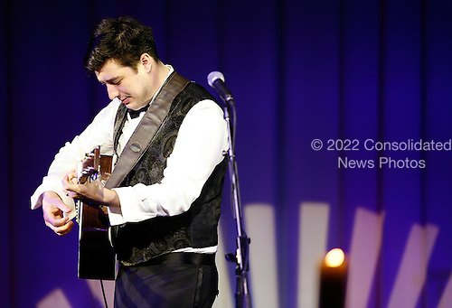 Lead singer of the band Mumford & Sons, Marcus Mumford performs during a state dinner, hosted by U.S. President Barack Obama for British Prime Minister David Cameron, at the South Lawn of the White House March 14, 2012 in Washington, DC. Prime Minister Cameron was on a three-day visit in the U.S. and he had talks with President Obama earlier the day.  .Credit: Brendan Hoffman / Pool via CNP