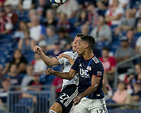 FOXBOROUGH, MA - JUNE 27: Kai Wagner #27 and Juan Agudelo #17 battle for head ball during a game between Philadelphia Union and New England Revolution at Gillette Stadium on June 27, 2019 in Foxborough, Massachusetts.