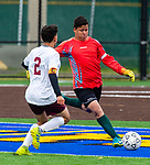 WATERBURY,  CT-101619JS24-  Wilby goal keeper Orlando Coello clears the ball while getting pressure from  Sacred Heart's Eddy Romero (2)  during their NVL game Thursday at Municipal Stadium in Waterbury. <br />  Jim Shannon Republican-American